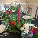 a purple and red christmas table